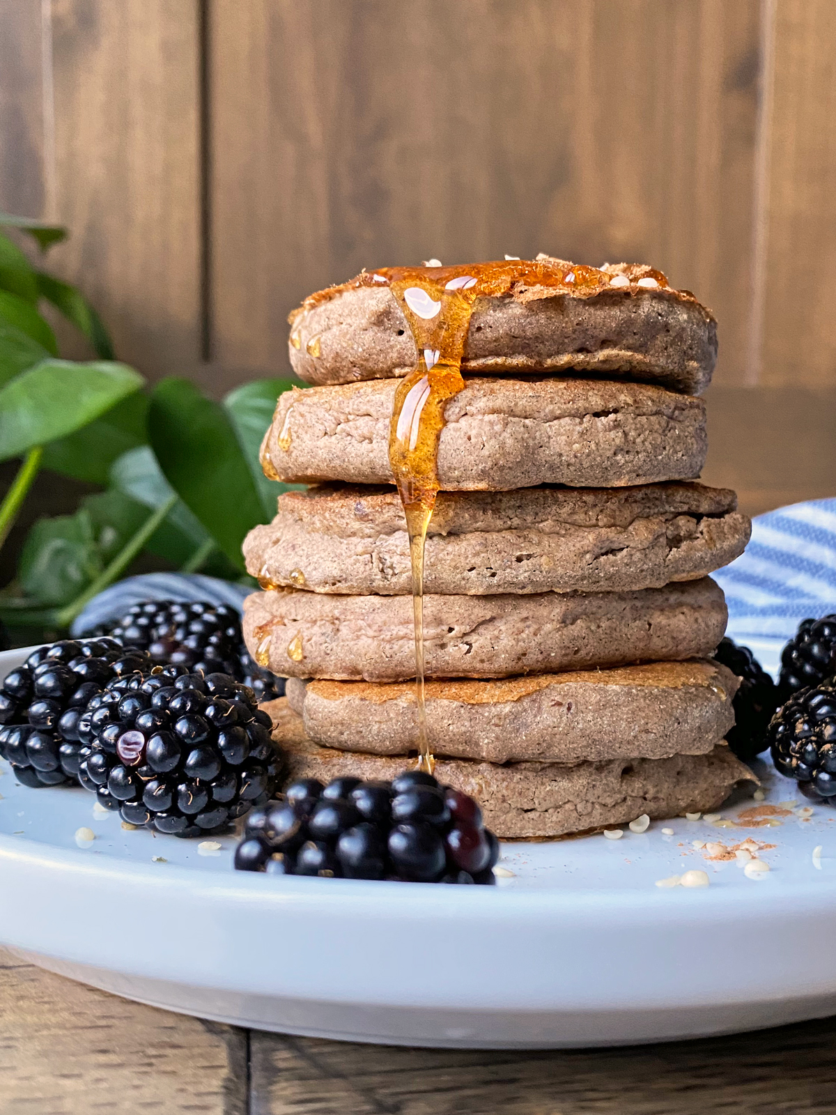 A-stack-of-plantain-pancakes-with-blackberries-and-honey