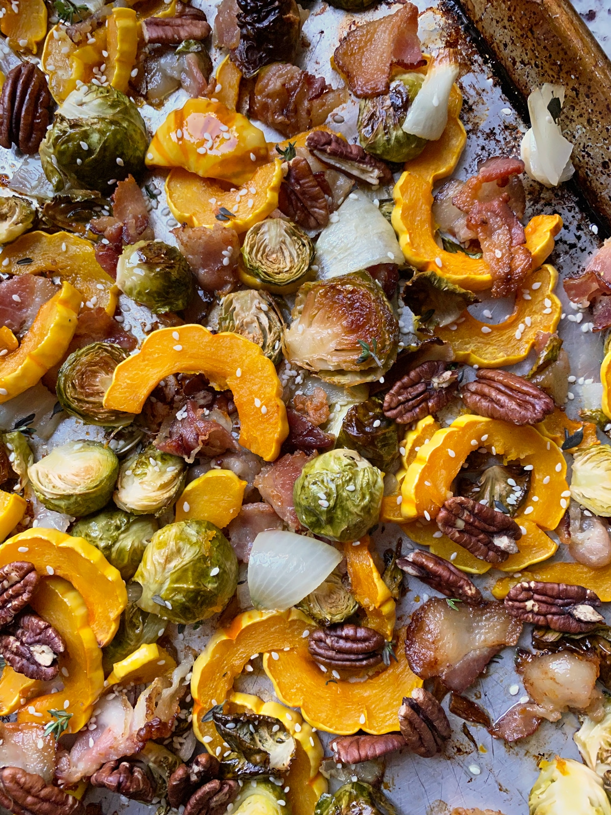 healthy-roasted-delicata-squash-brussels-sprouts-bacon-on-baking-pan