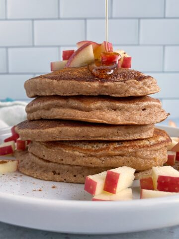 drizzling-maple-syrup-onto-applesauce-pancakes