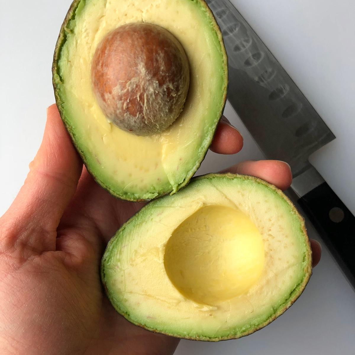 step two - cut avocado in half