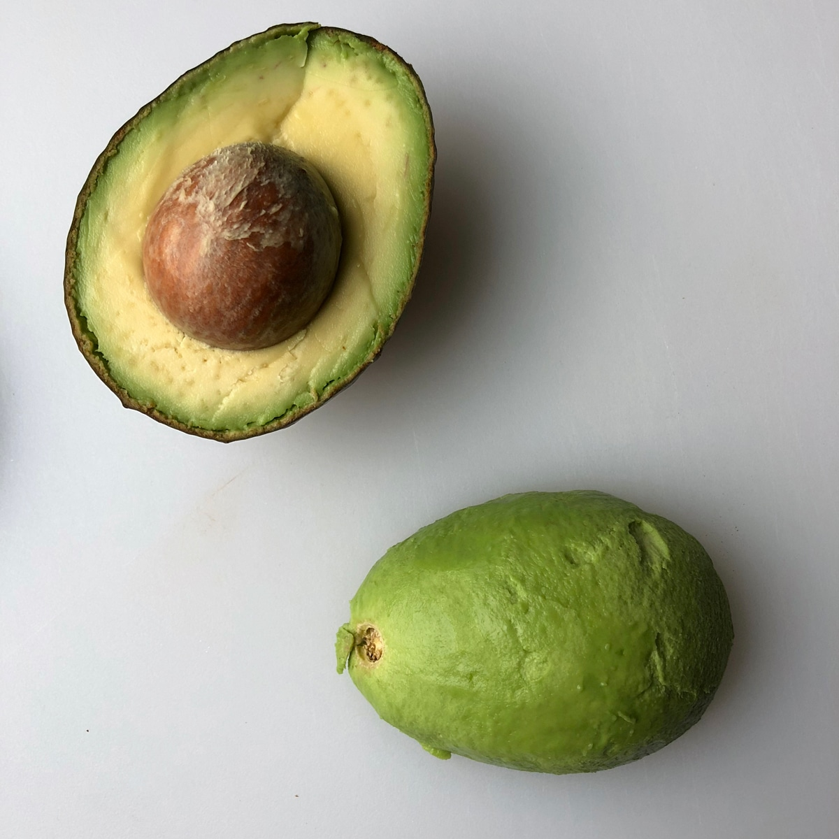 step three - peel one half of avocado and set face down on cutting board