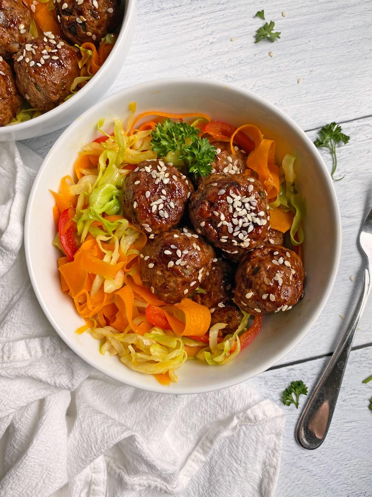 sesame meatballs on veggie noodles