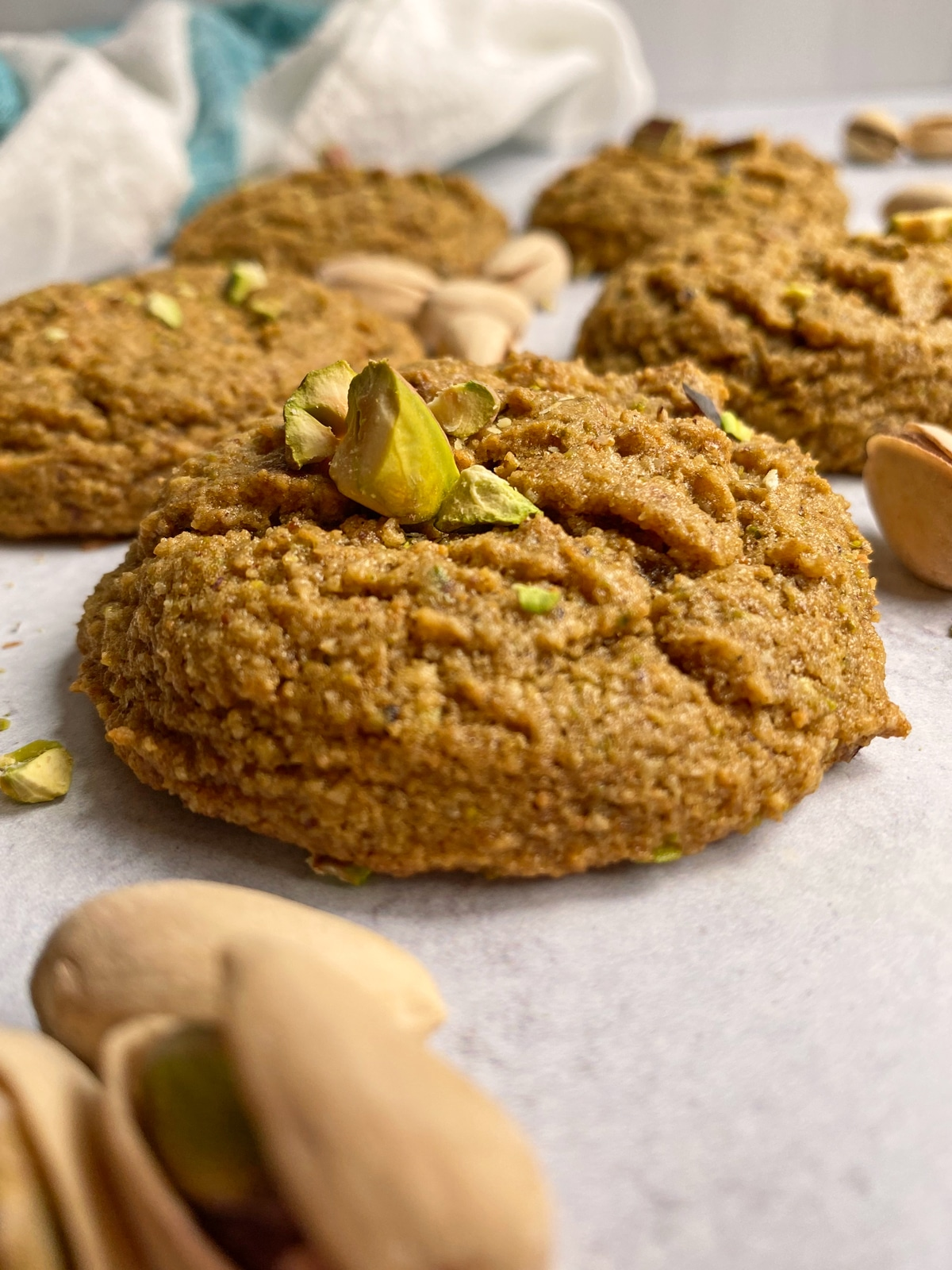 side view of pistachio cookie with crushed pistachios on top