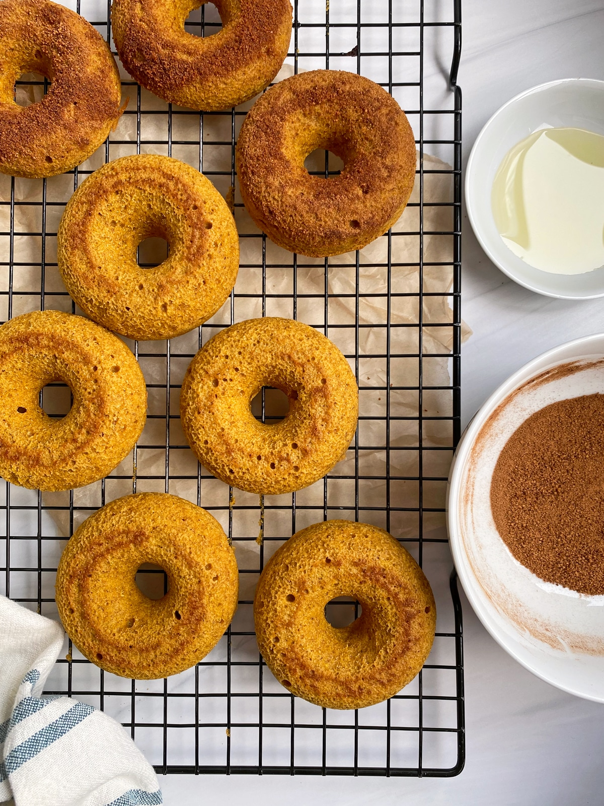 putting the cinnamon sugar on the donuts